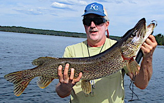 BIG Northern Pike Quest Fishing by Kris Gamble at Fireside Lodge in Canada