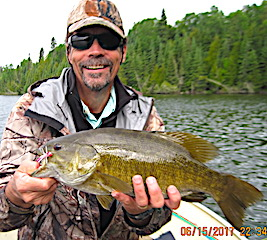 Super Trophy Fishing For Smallmouth Bass at Fireside Lodge  in Canada by Bill