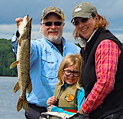 Ade Fishing with her First Northern Pike ever At Fireside Lodge in Canada