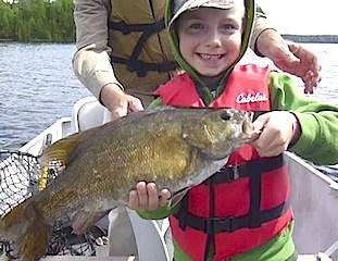 Trophy Smallmouth Bass Fishing at Fireside Lodge by 6 year old Isaac