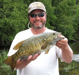 1st Trophy Smallmouth Bass Fishing Fireside Lodge Canada by Scott Carson