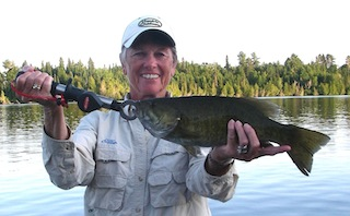 Ladies Trophy Fishing Smallmouth Bass at Fireside Lodge Canada