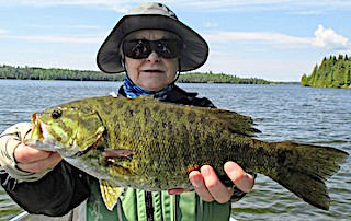 Becky with a Very Large Smallmouth Bass Fishing at Fireside Lodge in Northwest Ontario Canada