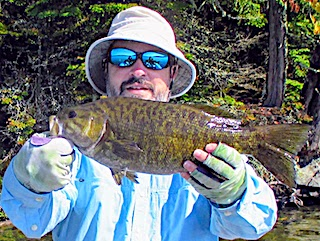 Fly Fishing for HUGE Smallmouth Bass at Fireside Lodge in Canada by Todd
