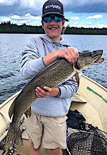 BIG Northern Pike Tyler Fishing at Fireside Lodge in Canada