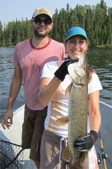 Couples Fishing Northern Pike at Fireside Lodge Canada
