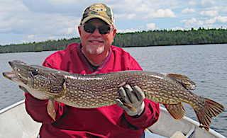 Biggest Northern Pike ever Twice in 1 day Fishing by Dan at Fireside Lodge in Canada