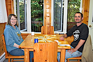 Pritzl Family Nighttime Cabin Fun with a Dice Game  at Fireside Lodge in Canada