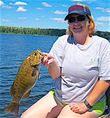 Traci Fishing Trophy Smallmouth Bass at Fireside Lodge