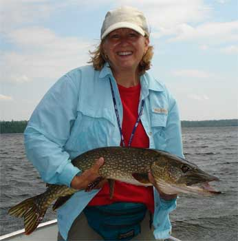 ladies fishing big pike at canada lodge