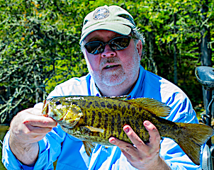 One of over 100 BIG Smallmouth Bass Fishing by Gerald Adams at Fireside Lodge