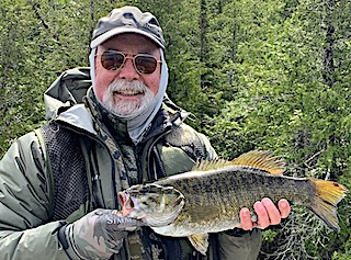 Jan with Another Trophy Smallmouth Bass Fishing at Fireside Lodge in Canada