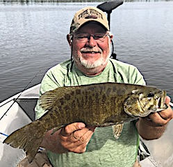 Super Surface Action for BIG Trophy Smallmouth Bass by Jerry at Fireside Lodge