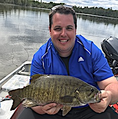 Ben With a Monster Trophy Smallmouth Bass Fishing at Fireside Lodge