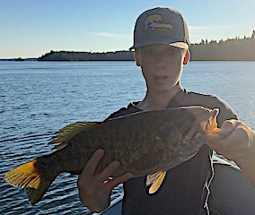 My First Trophy Smallmouth Bass Fishing by Tobin at Fireside Lodge in Canada