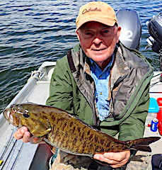 Bob Fishing Trophy Smallmouth Bass at Fireside Lodge in Canada