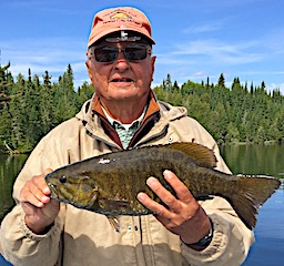Dan Ellis Fishing Trophy Smallmouth Bass at Fireside Lodge in Canada