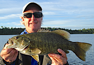 Three Trophy Smallmouth Bass Fishing at Fireside Lodge in Canada by Doug