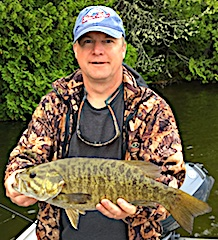 Todd with a GIANT Trophy Smallmouth Bass Fishing at Fireside Lodge in Canada