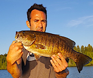 Top-water Fishing for Giant Trophy Smallmouth Bass by Pete at Fireside Lodge in Northwest Ontario Canada