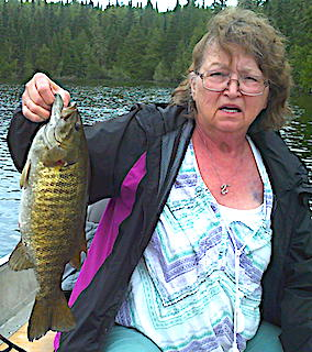 1st Trophy Smallmouth Bass by Debbie Fishing in Canada