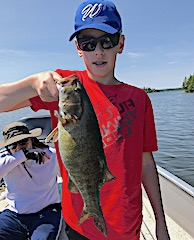 Trophy Smallmouth Bass Fishing at Fireside Lodge in Canada by Brian