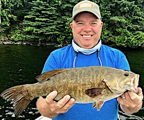 Huge 22-inch Trophy Smallmouth Bass by Dan Ramsey Alias BOB Fishing at Fireside Lodge in Canada