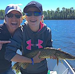 Mia Having a Blast wit Holli Fishing Northern Pike at Fireside Lodge in Canada