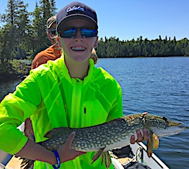 Mia Having Fun Fishing Northern Pike in Canada