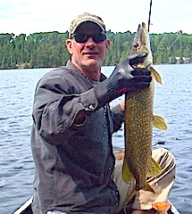 Fishing Northern Pike in a Canoe at Fireside Lodge Canada