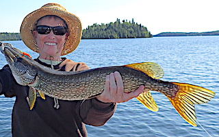 BIG Smile BIG Northern Pike Fishing by Ollie at Fireside Lodge in Northwest Ontario Canada