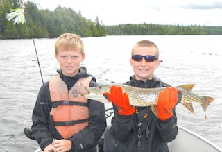 Brothers Fishing Northern Pike at Fireside Lodge in Canada