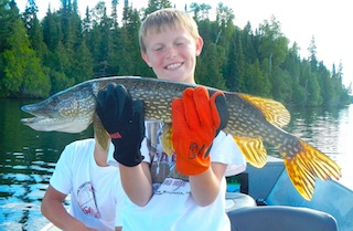 10-year Old Fishing Northern Pike at Fireside Lodge Canada