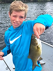 Kids Fishing Smallmouth Bass at Fireside Lodge by Michael