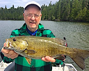 Phil with a HUGE Trophy Smallmouth Bass Fishing at Fireside Lodge in Canada