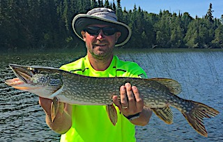 Super Northern Pike Fishing by Brad at Fireside Lodge in Canada