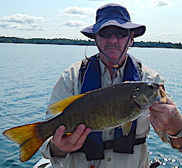 Larry with a HOG Trophy Smallmouth Bass Fishing at Fireside Lodge in Canada