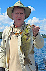 Ed Fishing Trophy Smallmouth Bass at Fireside Lodge in Canada