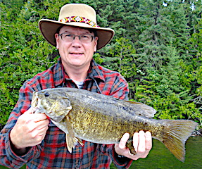 Terrific Smallmouth Bass Trophy Fishing by Rich at Fireside Lodge in Canada