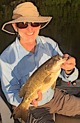Dennis with one of Many Smallmouth Bass Fishing at Fireside Lodge in Canada
