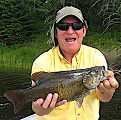 Mike Having a Blast Fishing Smallmouth Bass at Fireside Lodge in Canada