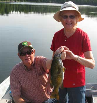women fishing for trophy smallmouth bass in Canada