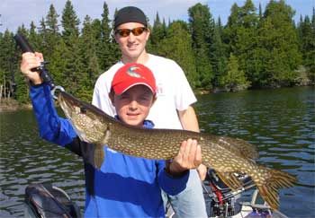 father and son fishing at canada lodges