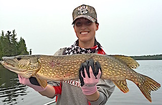 Cathy Fishing for BIG Pike at Fireside Lodge