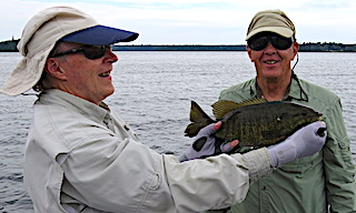 Fly Fishing Trophy Smallmouth Bass at Fireside Lodge in Canada by Doug
