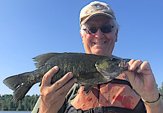 GREAT BIG Smallmouth Bass Great Big Smile by John Fishing at Fireside Lodge in Canada