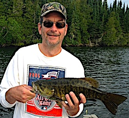 Mike with Another Trophy Smallmouth Bass Fishing at Fireside Lodge in Canada