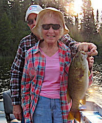 Another BIG Trophy Smallmouth Bass Fishing by Audrey Held by Don at Fireside Lodge