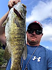 Trophy Smallmouth Bass Fishing by Aaron in Canada