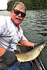 Bill in Action Fishing For Muskie at Fireside Lodge in Canada